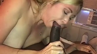 Hotwife sucking a big black cock