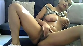 Young housewife fingering her black meaty pussy