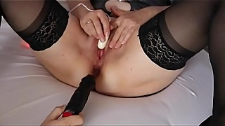 Betty Belle in sexy silver take black dildo anal while blowing