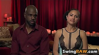 White and black couples having swinging fun