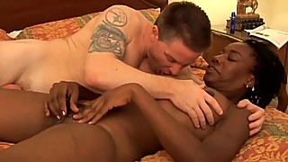Super sexy slim black MILF fucks a lucky white guy