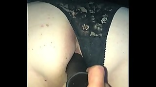 Playing with black dildo